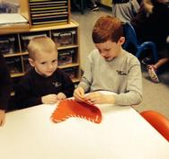 PreSchool students making crafts with 3rd grade buddies.